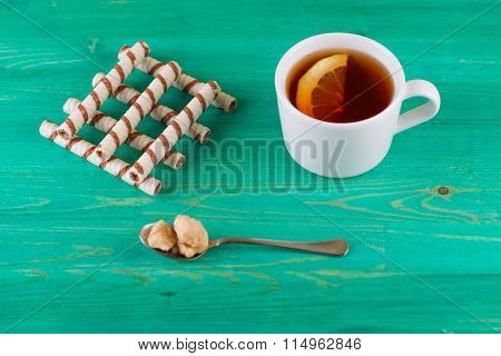 Tubules wafer and tea with a lemon