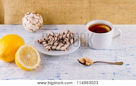 Tubules wafer and tea with a lemon on