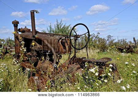 Old tractor missing wheels