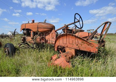 Orange junked tractor