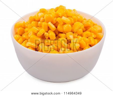 Corn grains in a white cup, on a