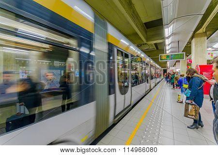 BRUSSELS, BELGIUM - 11 AUGUST, 2015: Inside Beurs station on passenger platform showing grey train a