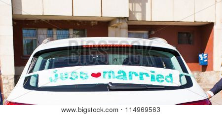 Wedding car with just married sign