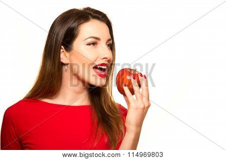 Positive Female Biting A Big Red Apple Fruit Smiling On White Background Looking Away