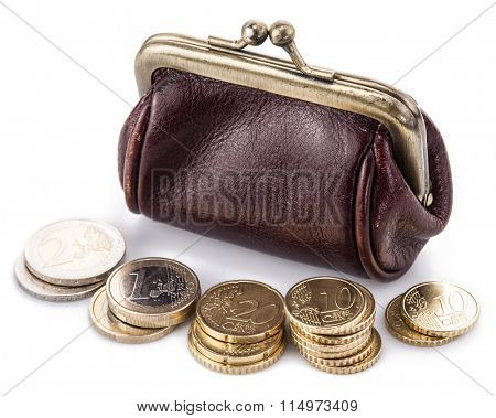 Small leather purse for coins and coins near it. Isolated on white background.