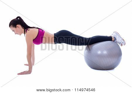 Slim Woman In Sports Wear Doing Push Up Exercises On Fitness Ball Isolated On White