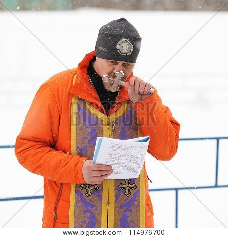 Orel, Russia - January 19, 2016: Russian Epiphany Feast. Orthodox Priest Kissing Cross For Blessing