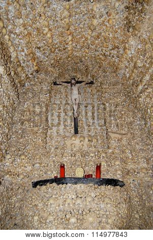 Human skulls and bones fixed in the wall of the Chapel of Bones (Capella dos Ossos) at Alcantarilha.