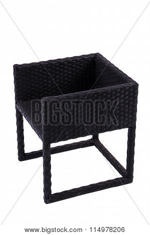 Black chair made of artificial rattan