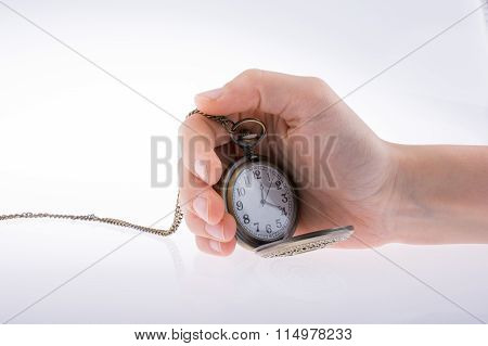 Holding A Pocket Watch