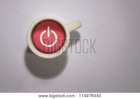 Full Coffee Mug With A Red Power Button