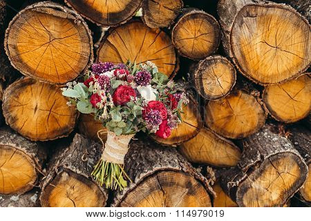Wedding Bouquet With Red Rose And Lilac Flowers On Wooden Background