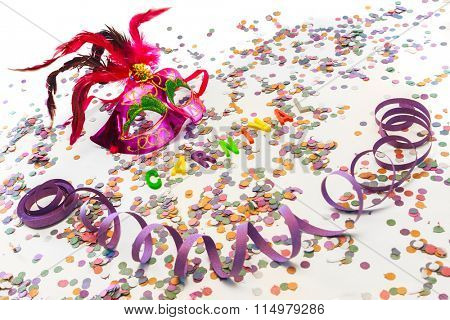 Carnival mask, serpentine and confetti on white background