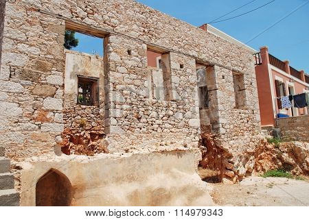 A derelict old stone building at Emborio on the Greek island of Halki. The village has a number of abandoned old buildings.