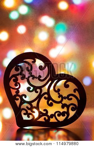 Silhouette Of Tracery Heart With Garland Lights On Background In Vintage Style