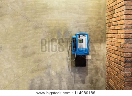 Public Payphones On The Rough Cement Wall