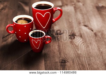 Three red coffee cups