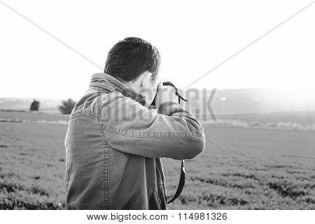 Men take a photo about beautiful landscapeMen take a photo about beautiful landscape