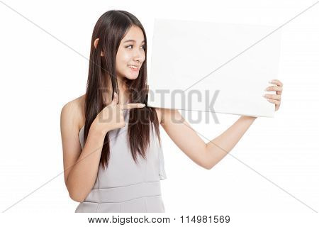 Beautiful Young Asian Woman Point To Blank Sign