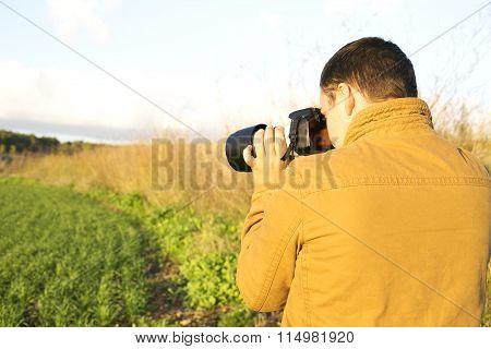 Men take a photo about beautiful landscape