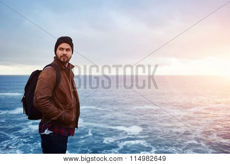 Stylish hipster guy enjoying vacations