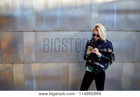 Young female using mobile smart phone