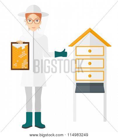 Bee-keeper at apiary.