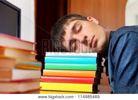 Young Man Sleep On The Books