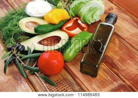 prepared vegetables on wood with sour cream
