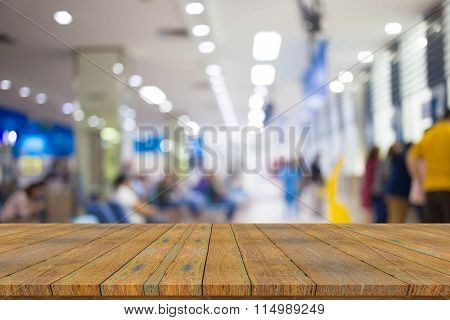 Empty Wood Table With Blur  Patient Waiting For See Doctor At Hospital,abstract Background.