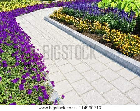 Tiled Path In A Blooming Summer Garden