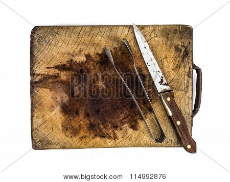 Knife And Tongs On A Wooden Chopping Board Isolated On White Background,vintage Tone