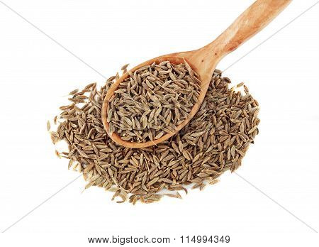 close-up of dried cumin in a wooden spoon
