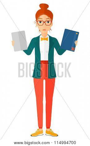 Woman choosing between book and tablet.