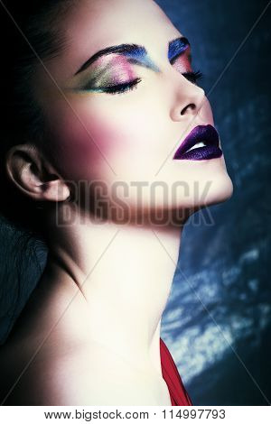 young beautiful woman with perfect make up, closeup face, studio, eyes closed