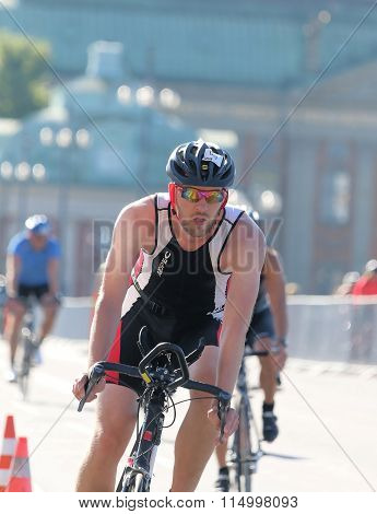 Close-up Of Man Cycling In A Curve, Wearing Colorful Sun-glasses