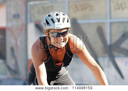 Smiling, Cycling Woman Wearing Black Tank-top, Close-up