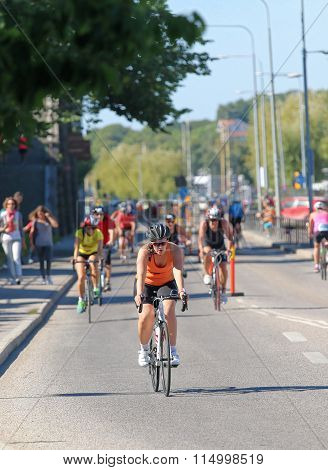 Cycling Woman Followed By Group Of Competitors