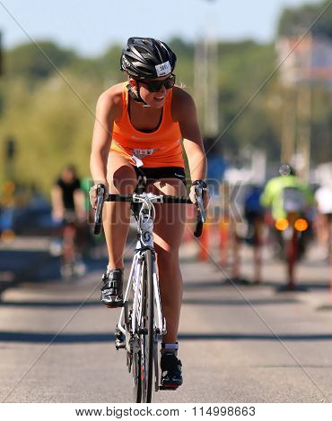 Cycling Young Woman Wearing Oranges Tank Top