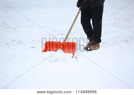 Man With Snow Shovel Cleans Sidewalks