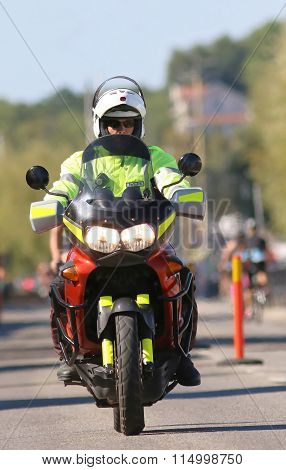 Man In Green Vest Driving Motorcycle Working As Officer
