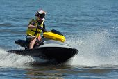 stock photo of ski boat  - Man Riding Jet Ski Wet Bike Personal Watercraft - JPG