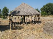stock photo of mud-hut  - view of a traditional hut in north Cameroon - JPG