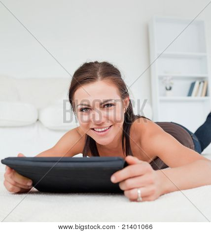 Cute Woman Working On Her Tablet