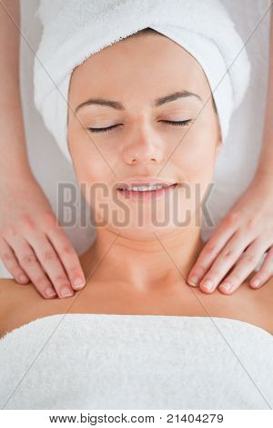 Delighted Woman Having A Shoulder Massage