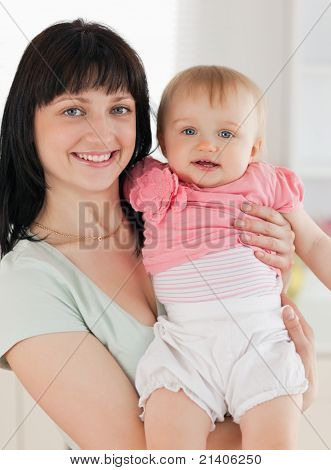 Good Loooking Woman Holding Her Baby In Her Arms While Standing