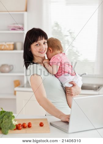 Good Looking Brunette Woman Holding Her Baby In Her Arms