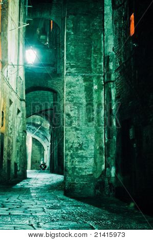 Night Alley in old city of Siena, Tuscany, Italy
