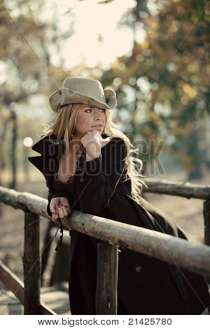 Outdoor Country Style Fashion Portrait of Beautiful Blond Young Woman