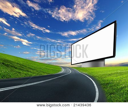 blank white billboard on the edge of country road